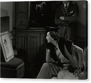 Betty Mclauchlen Looking At An Illustration Canvas Print by Edward Steichen