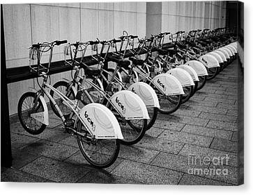 Sharing Canvas Print - Bicing Bicycle Sharing System In Barcelona Catalonia Spain by Joe Fox
