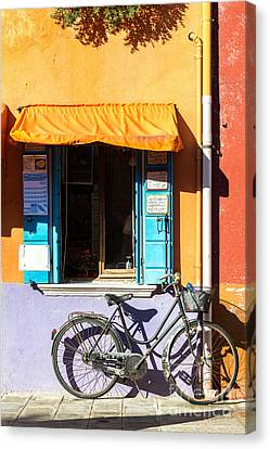 Bicycle In Front Of Colorful House - Burano - Venice Canvas Print by Matteo Colombo