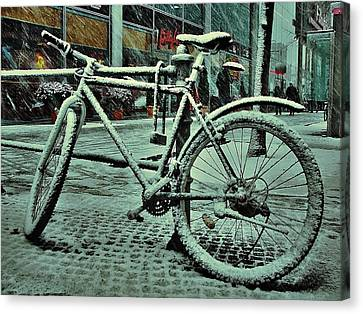 Bicycle In The Snow Canvas Print by Marco Oliveira