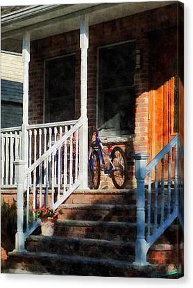 Bicycle On Porch Canvas Print by Susan Savad