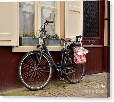 Bicycle With Baby Seat At Doorway Bruges Belgium Canvas Print by Imran Ahmed