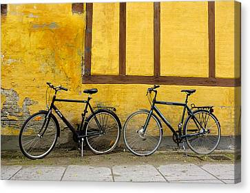 Bicycles Aarhus Denmark Canvas Print by John Jacquemain