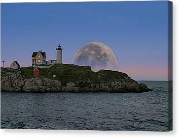 Big Moon Over Nubble Lighthouse Canvas Print by Jeff Folger