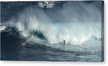 Big Wave Surfers Maui Canvas Print by Bob Christopher