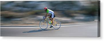 Bike Racer Participating In A Bicycle Canvas Print by Panoramic Images