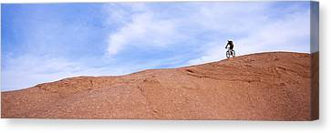 Biker On Slickrock Trail, Moab, Grand Canvas Print by Panoramic Images