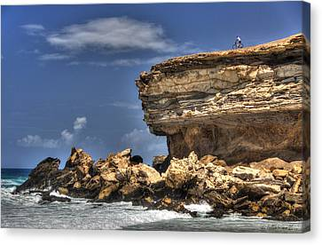 Canvas Print featuring the photograph Biker On The Rocky Cliff At La Pared by Julis Simo