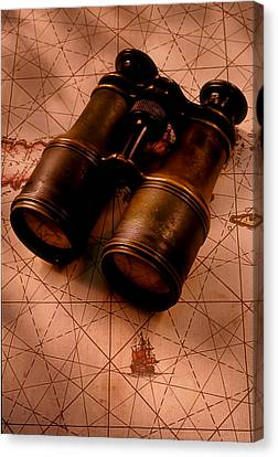Binoculars On Old Map Canvas Print by Garry Gay