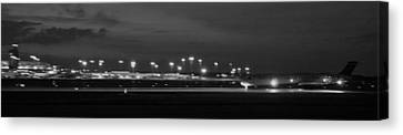 Black And White Jet Landing At Gerald R Ford Airport Canvas Print by Rosemarie E Seppala