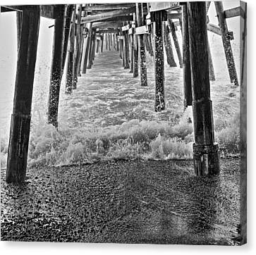 Black And White Under The Pier Canvas Print by Richard Cheski
