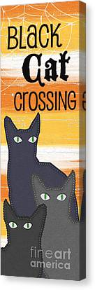 Black Cat Crossing Canvas Print by Linda Woods