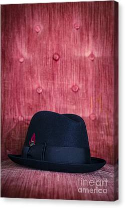 Black Hat On Red Velvet Chair Canvas Print by Edward Fielding