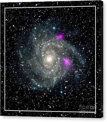 Black Holes In Spiral Galaxy Nasa Canvas Print by Rose Santuci-Sofranko