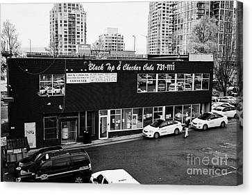 black top and checker cabs office Vancouver BC Canada Canvas Print by Joe Fox