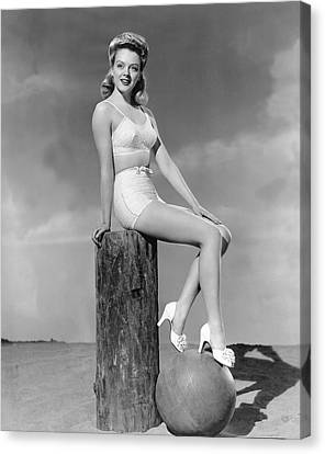 Blonde On A Piling Canvas Print