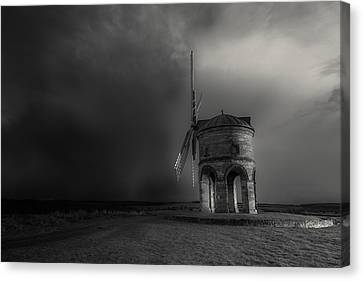 Blowing Away The Darkness Canvas Print by Chris Fletcher