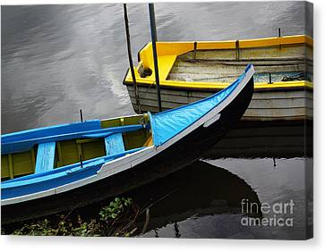 Blue And Yellow Boats Canvas Print by Carlos Caetano
