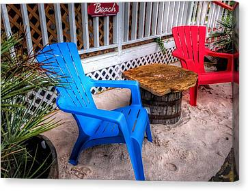 Blue And Red Chairs Canvas Print by Michael Thomas