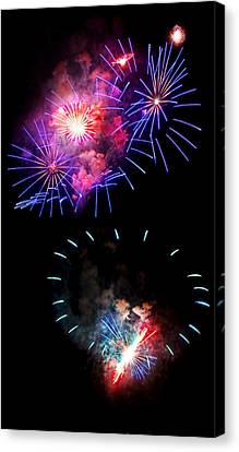 Blue And Red Firework Disks Canvas Print