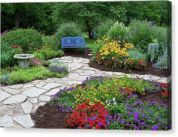 Blue Begonia Canvas Print - Blue Bench, Birdbath And Stone Path by Panoramic Images