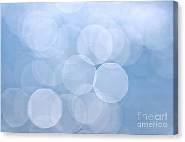 Blue Bokeh Background Canvas Print by Elena Elisseeva