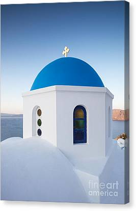 Blue Domed Church In Oia Santorini Greece Canvas Print by Matteo Colombo