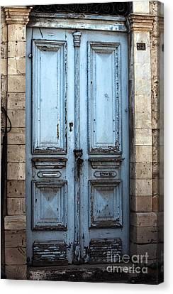 Blue Door In Limassol Canvas Print by John Rizzuto