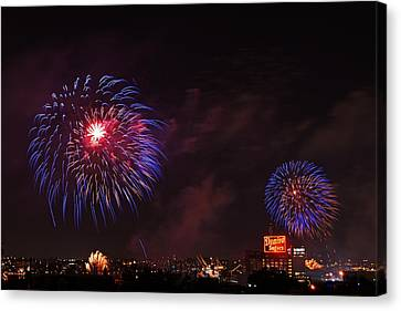 Blue Fireworks Over Domino Sugar Canvas Print by Bill Swartwout