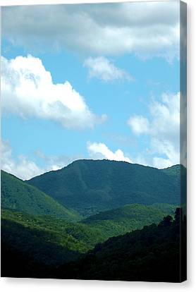 Blue In The Sky Canvas Print by Russell Clenney