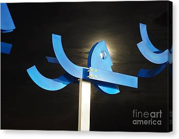 Blue Man Moon Canvas Print by Lynda Dawson-Youngclaus