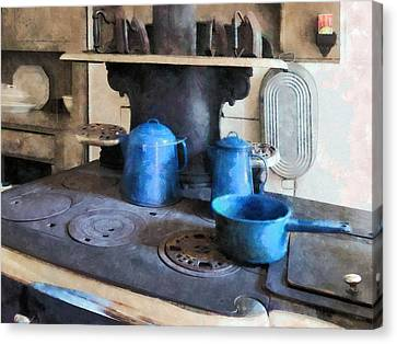 Blue Pots On Stove Canvas Print by Susan Savad