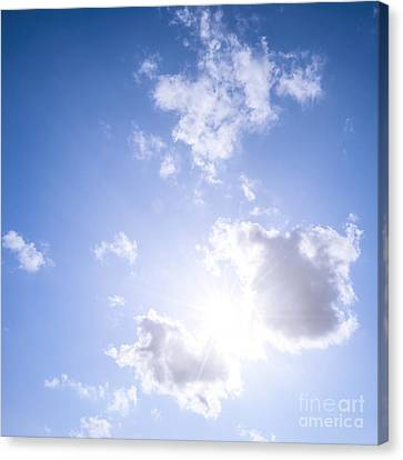 Blue Sky With Sun And Clouds Canvas Print by Elena Elisseeva