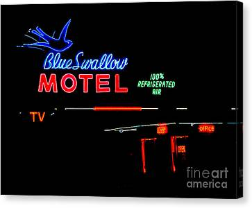 Blue Swallow Motel Neon Sign Canvas Print by Catherine Sherman
