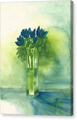 Blue Tulips In Glass Vase Canvas Print