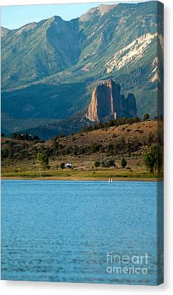 Canvas Print featuring the photograph Blue Water And Needlrock by Eric Rundle