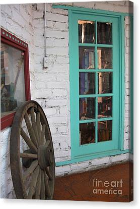 Canvas Print featuring the photograph Blue Window And Wagon Wheel by Dora Sofia Caputo Photographic Art and Design