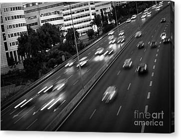 Blurred Cars Canvas Print by Carlos Caetano