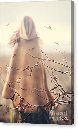 Canvas Print featuring the photograph Blurred Image Of A Woman With Cape by Sandra Cunningham