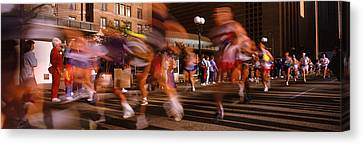 Blurred Motion Of Marathon Runners Canvas Print by Panoramic Images
