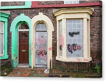 Boarded Up Houses Canvas Print by Ashley Cooper