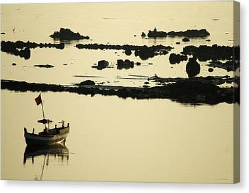 Boat Amongst The Rocks Canvas Print by Rajiv Chopra