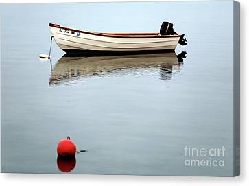 Boat In The Bay Canvas Print by John Rizzuto