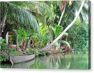Exoticism Canvas Print - Boat Lays Along A Kerala Canal by Steve Roxbury
