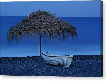 Boat On Beach Canvas Print by Saul Moreno