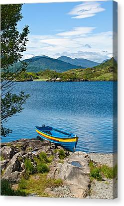 Boat On Upper Lake Killarney Canvas Print by Jane McIlroy