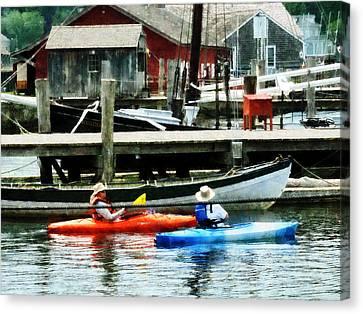 Sports Canvas Print - Boat - Orange And Blue Kayaks by Susan Savad