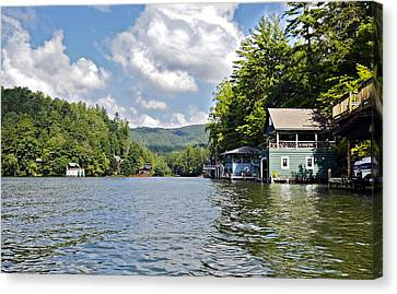 Boathouses On The Lake Canvas Print by Susan Leggett