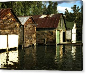 Boathouses On The River Canvas Print