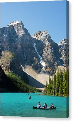 Boating, Moraine Lake, Reflection Canvas Print by Michel Hersen